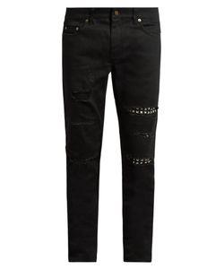 Saint Laurent | Distressed Stud-Trimmed Skinny Jeans