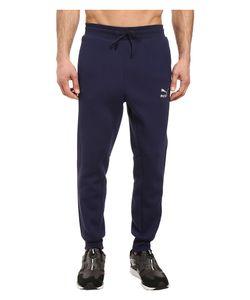 Puma   Evo T7 Sweatpants Peacoat Mens Casual Pants