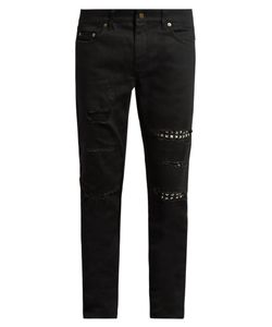 Saint Laurent | Distressed Stud-Trimmed Skinny Jeans